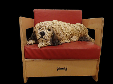 Dog in a Red Chair