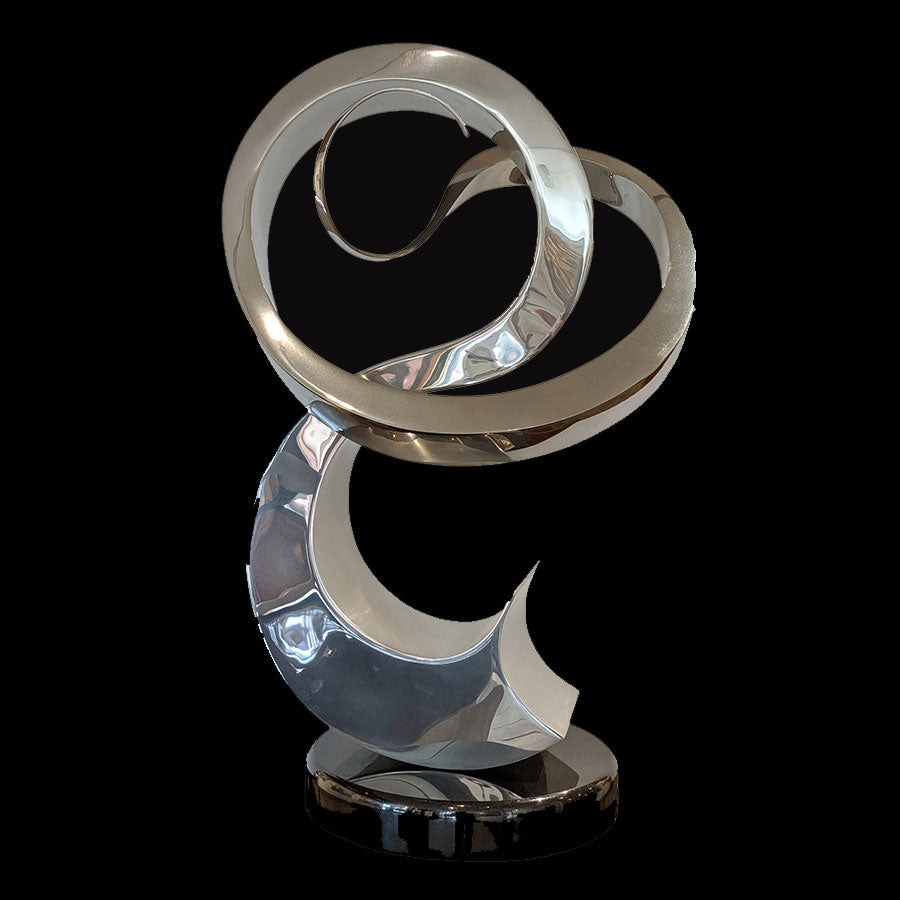Eclectic Dance stainless steal sculpture by Santa Fe New Mexico artist Gilberto Romero