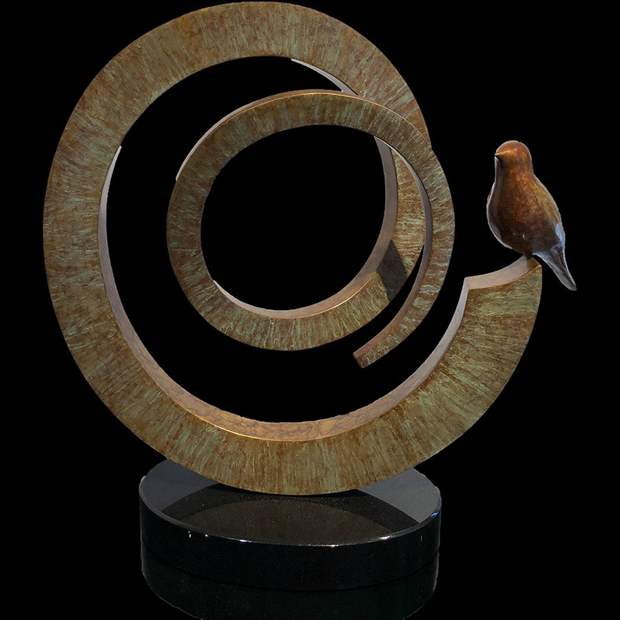 Full Circle bronze bird sculpture by artist Gilberto Romero