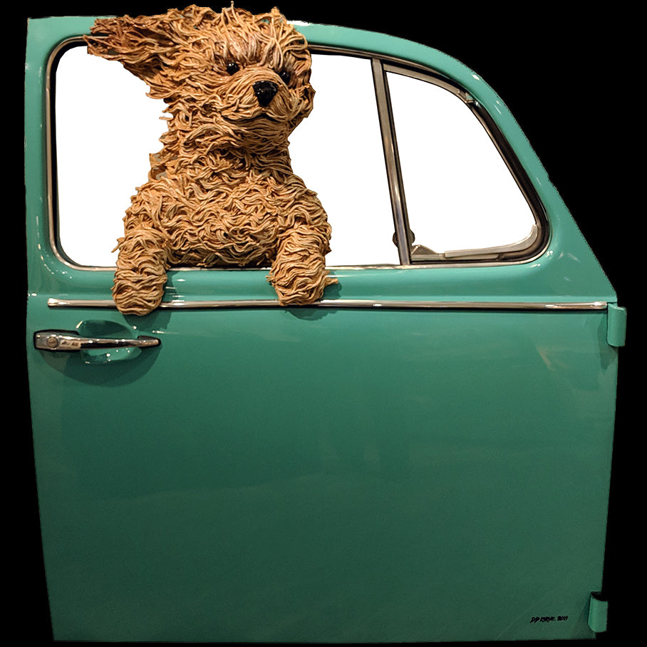 Golden doodle in teal volkswagen door original sculpture by colorado artist DD Larue