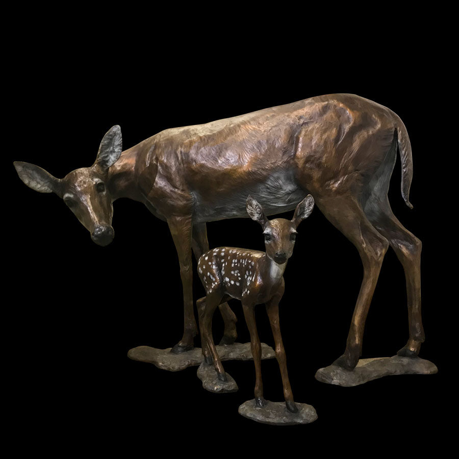 Life Size Doe and Fawn bronze sculpture by artist Marianne Caroselli