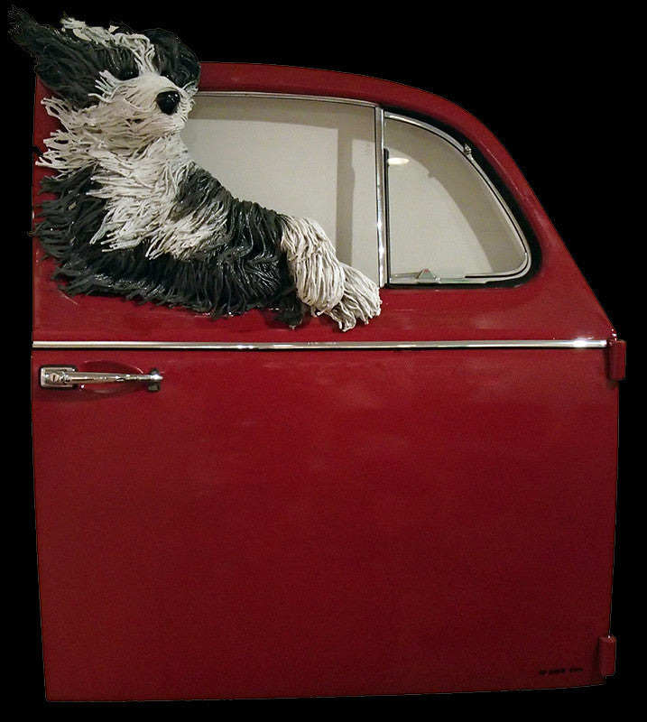 Lounging Sheepdog in a Red VW Door