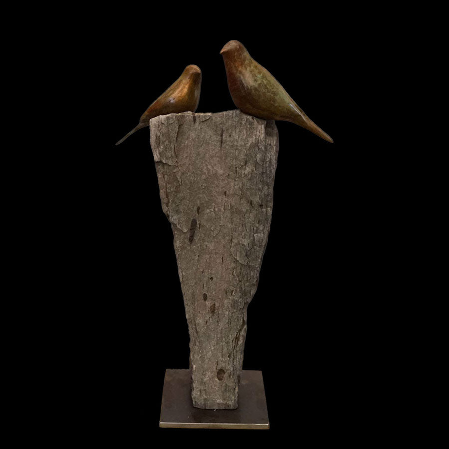 Songbird Abroad bronze and stone sculpture by artist Gilberto Romero
