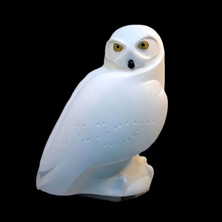 Stone snowy owl sculpture by Ellen Woodbury