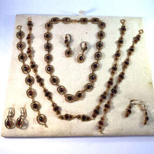 Extremely Rare Mid 1900s Full Display of Bohemian Garnet Jewelry.