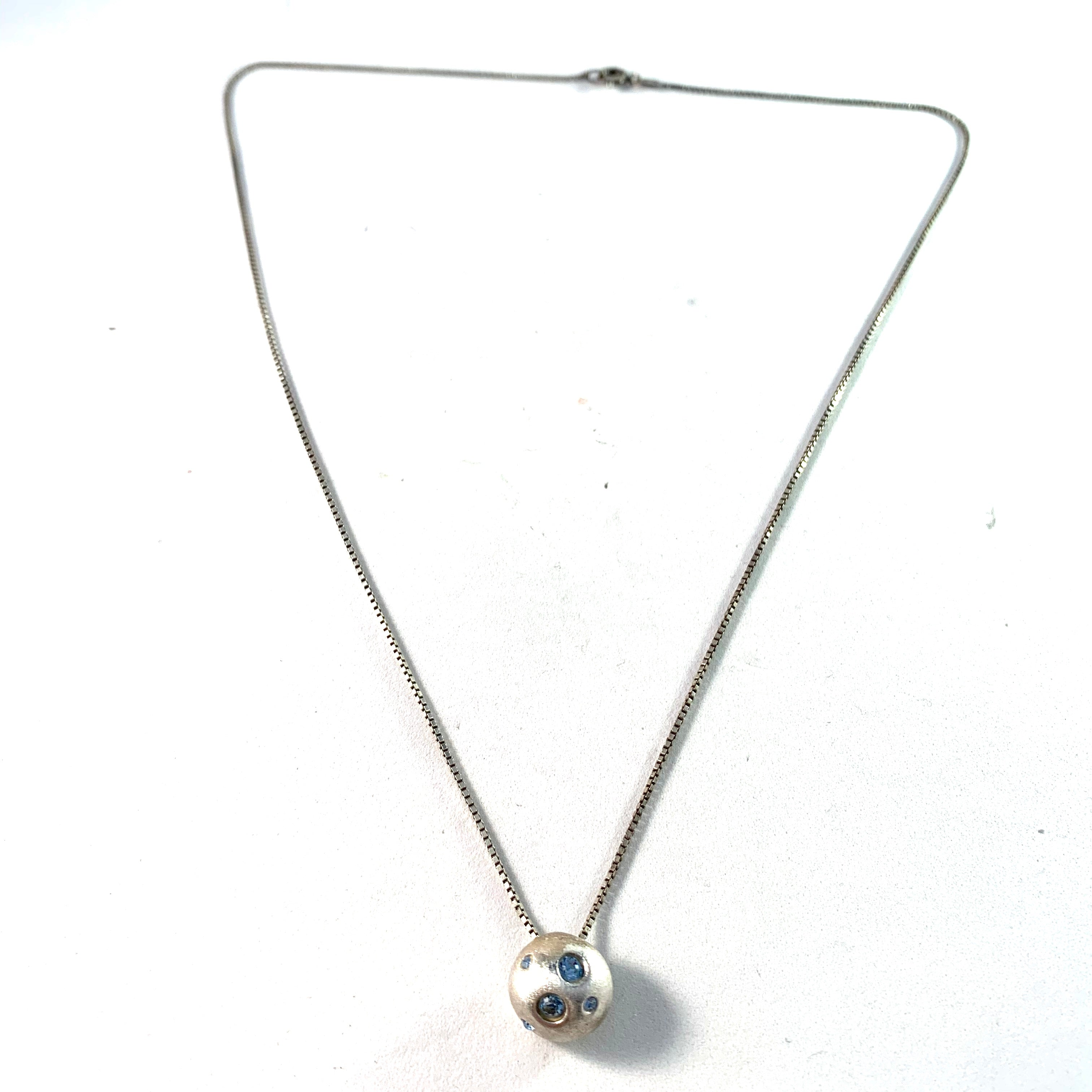 Yves Saint Laurent, France Sterling Silver Pendant Necklace.