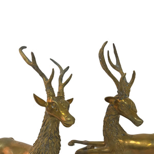 PAIR OF LARGE BRASS RECLINING DEER SCULPTURES - Flair Home Collection