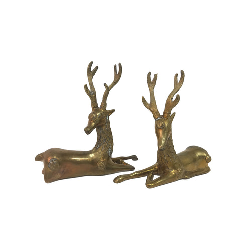 PAIR OF BRASS RECLINING DEER SCULPTURES - Flair Home Collection