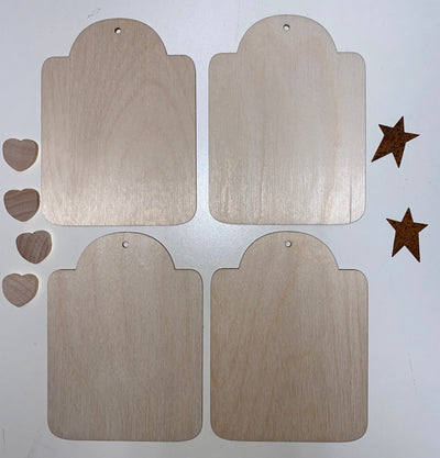 Set of four ornament with metal stars and wooden hearts