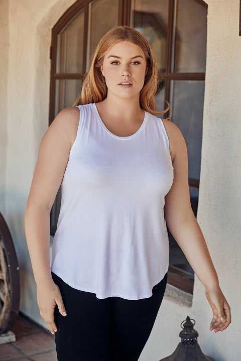 Plus size model in sleeveless top and black pants