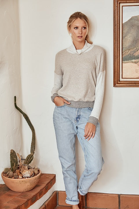 Model wearing light blue jeans and white sweater