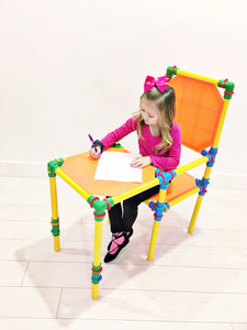 girl playing on building toy furniture