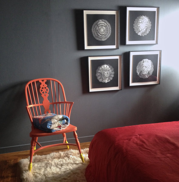 Room design by Shannon Kaye: Presidential doily prints by Ray beldner. Orange apinted Windsor chair with custom blue walls, pink silk bedspread sewn from salvaged curtains, and the Geo Fire bolster pillow made with a linen print of Shannon Kaye's painting.