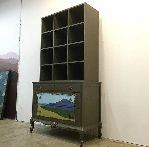 Shannon Kaye's Torn Landscape series includes paintings, pillows, furniture, and vintage painters boxes