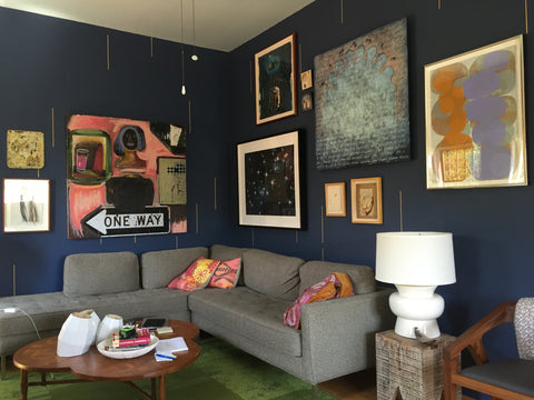 When two people come together in a space, bringing their eclectic art collection together is a great way to make everyone feel at home and connected.