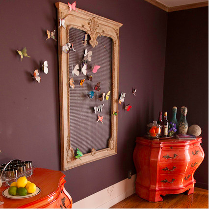 Shannon Kaye create this butterly installation with a vintage mirror frame, fencing wire, and magazine paper