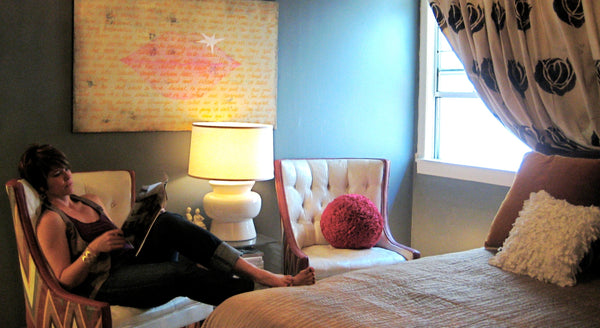 Shannon Kaye's room as seen in Apartment Therapy in 2011. Hand stenciled drop cloth curtains, painted upholstered chairs, Shannon's original 'Ode to Rocktar' painting