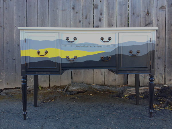 Torn Landscape on Vintage Sideboard
