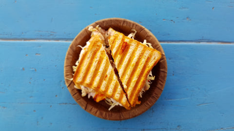Grilled cheese sandwich on blue table