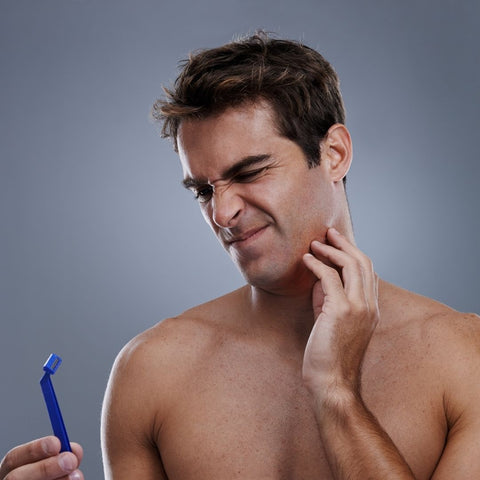 Frustrated man holding a razor