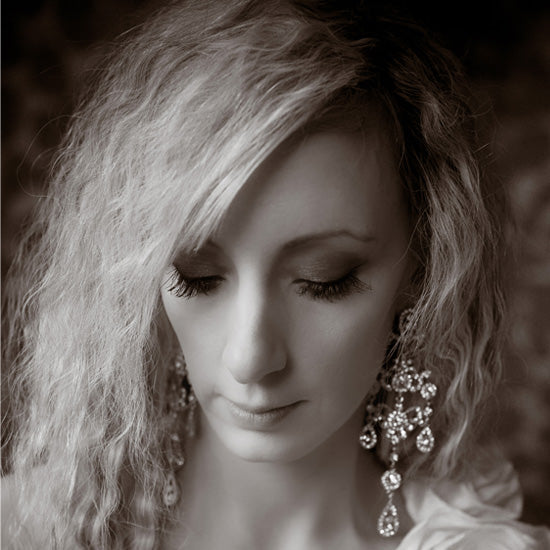 Kirstie wears Vintage Extravagance Earrings by Glitzy Secrets