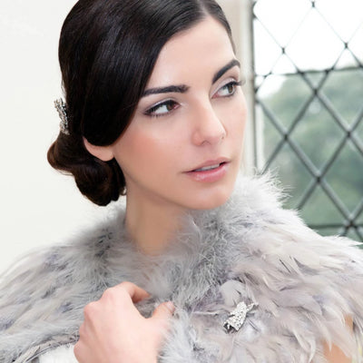Model wears Angel of Sparkle Brooch pinned to a fur cape.