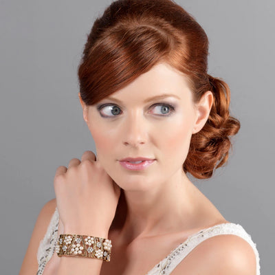Model bride wears Antique Enchantment gold floral bangle