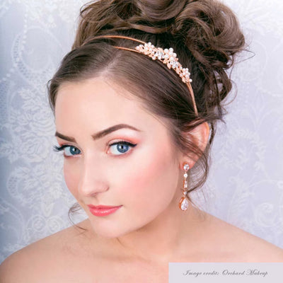 Blooms of Blush Headband show in a tousled wedding updo