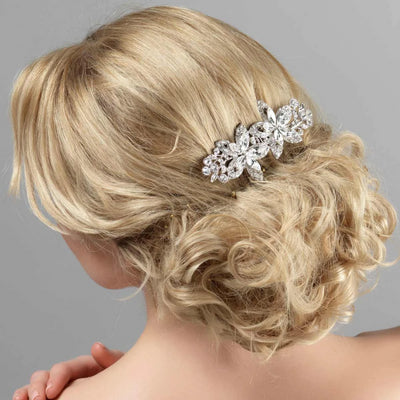Blooms of Extravagance Hair Comb shown in a tousled wedding updo