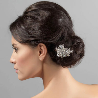 Bouquet of Beauty Bridal Hair Clip shown in a side chignon hairstyle