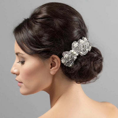 Bow of Pearls Wedding Hair Clip shown in a side chignon hairstyle