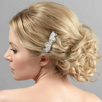 Bow of Pearls Hair Comb shown in a tousled wedding hairstyle