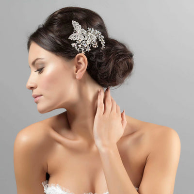 Butterfly of Enchantment Headpiece shown in a side chignon hairstyle