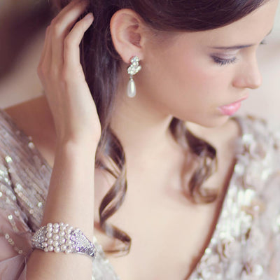 Model bride wears Bygone Pearl Bangle