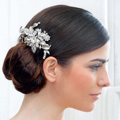 Captivating Starlet Wedding Headpiece shown in a side chignon hairstyle