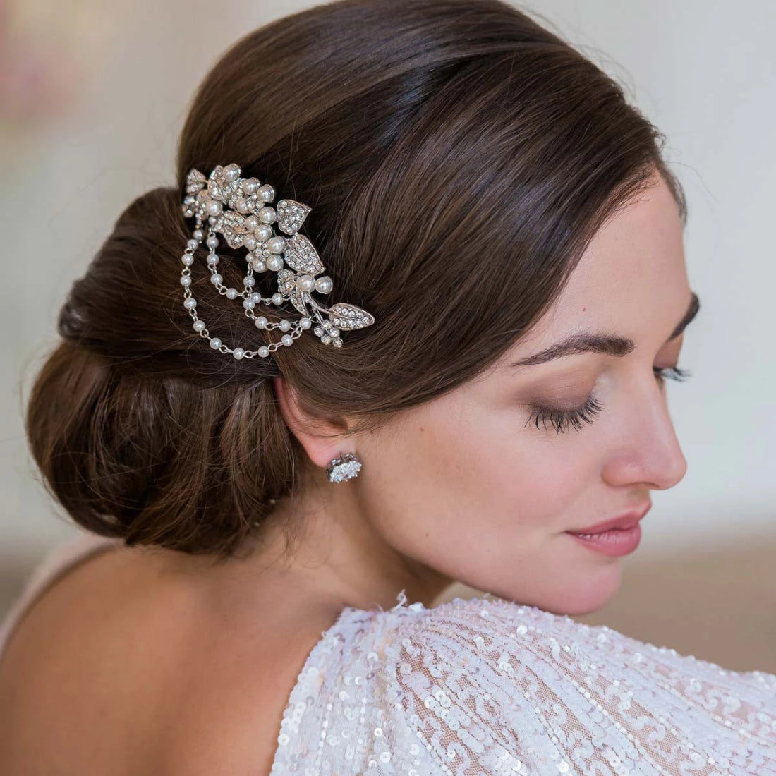 Cascades of Pearl Hair Comb shown in a side chignon wedding hairstyle