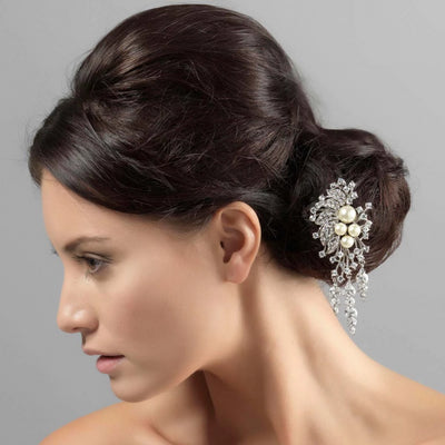 Cascading Bouquet Hair Pin shown in a side chignon bridal hairstyle