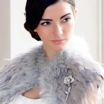 Model bride wears Corsage of Beauty Wedding Brooch
