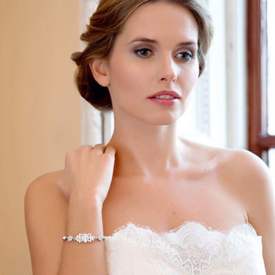 Model bride wears Delicate Pearl Wedding Bracelet