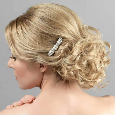 Divinely Pearl Bridal Hair Comb shown in a tousled wedding updo