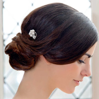 Dream Posy Bridal Hair Pin shown in a classic wedding side chignon