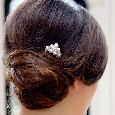 Dream Posy Wedding Hair Pin secured in a classic bridal chignon