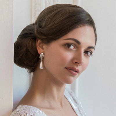 Elegance of Pearl Drop Wedding Earrings shown on our model bride