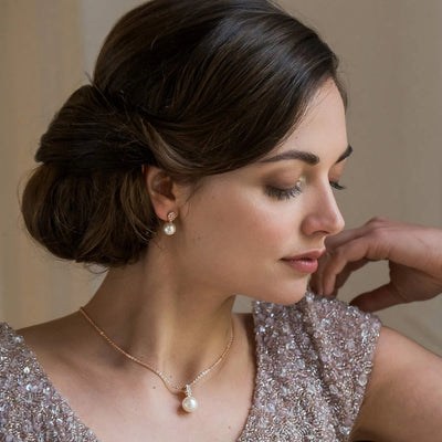 Model wears Elegance of Rose Gold Pearl Bridal Earrings