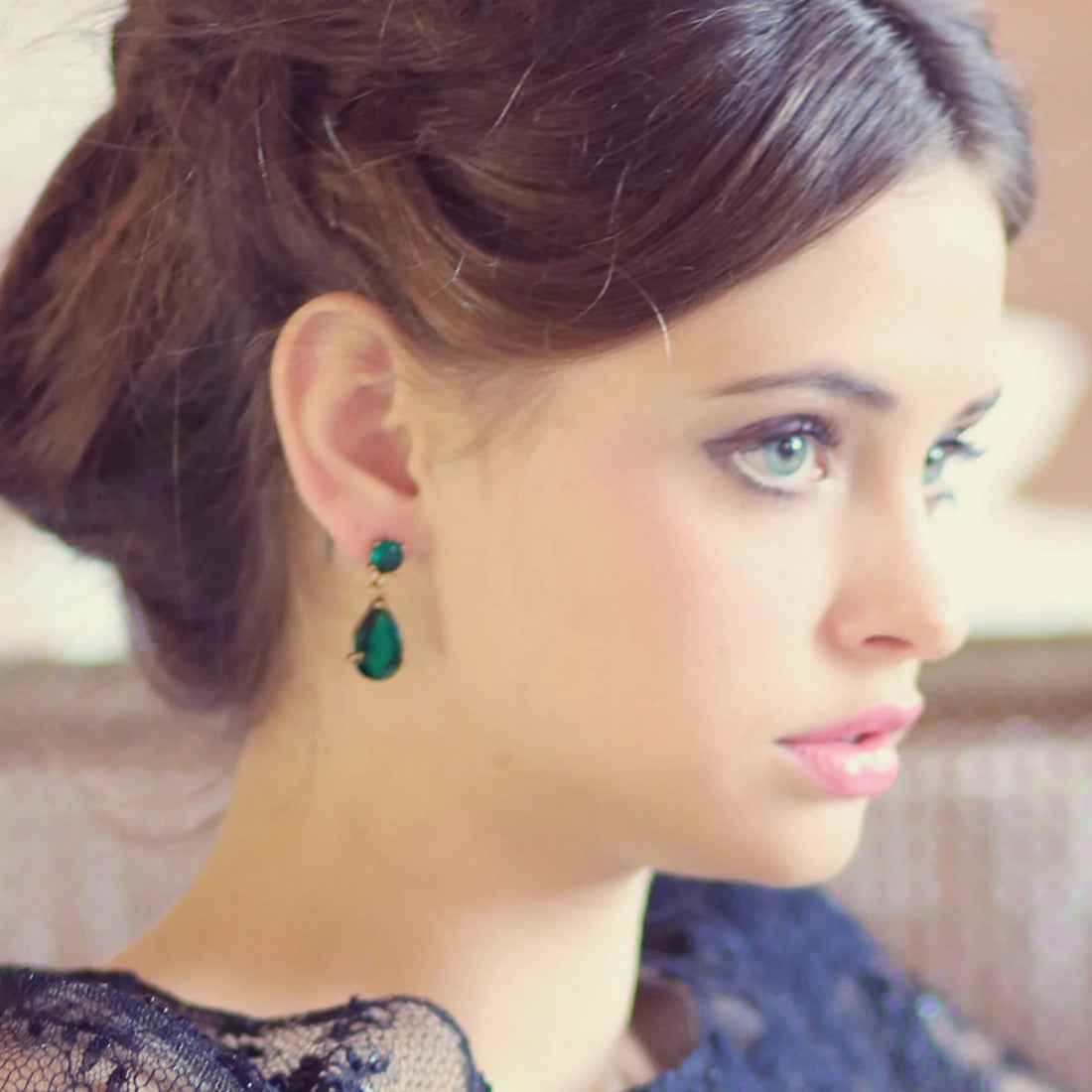 Model wears Emerald Enigma Drop Fashion Earrings