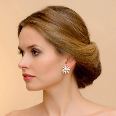 Model wears Enchanting Daisy Clip On Flower Earrings