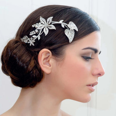 Floral Posy Headpiece styled in a bridal side chignon hairstyle
