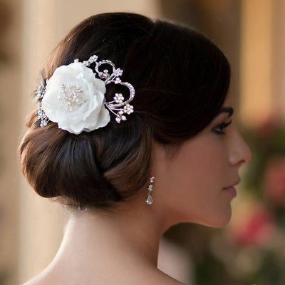 Flower of Elegance Hair Flower styled in a chignon bridal hairstyle