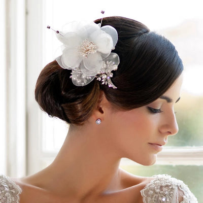 Flower of Romance Hair Flower styled in a chignon bridal hairstyle