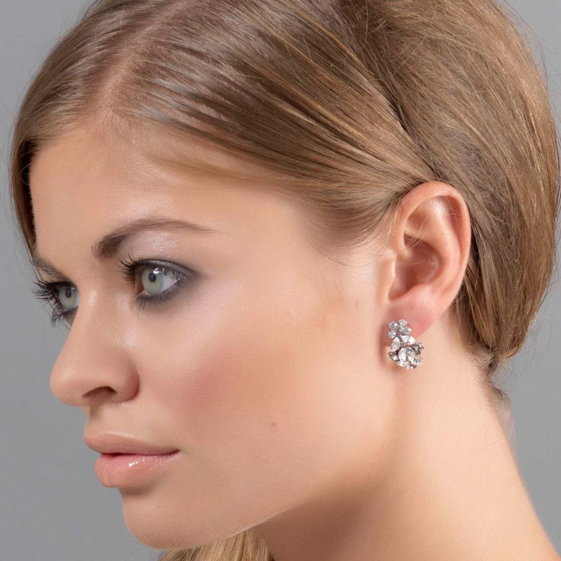 Model wears Forever Vintage Grey Crystal Clip On Earrings